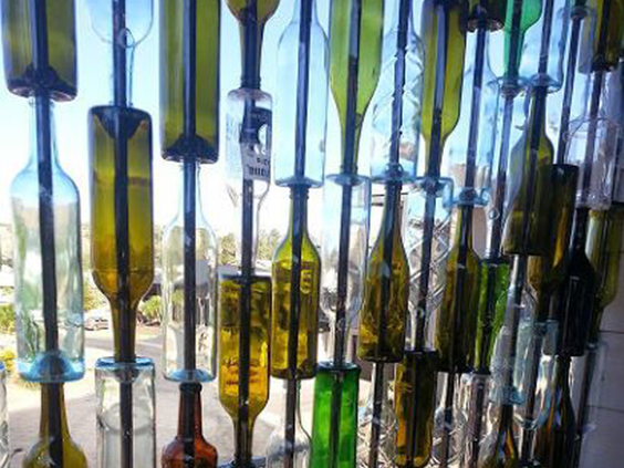 A Wall Made of Colorful Glass Bottles