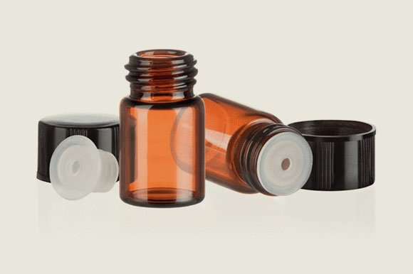 Amber glass vials with orifice reducer and black caps