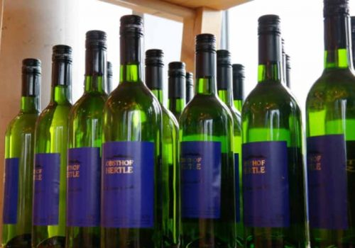 Green wine bottles with blue labels